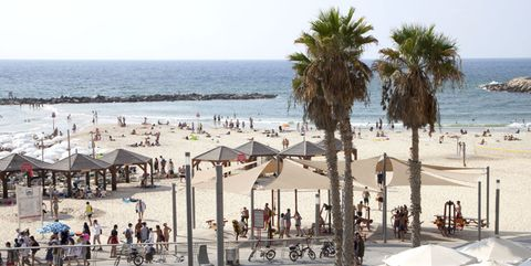 Body of water, Coastal and oceanic landforms, Tourism, Leisure, Shore, Beach, People on beach, Sand, Summer, Coast,