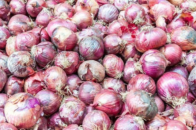 red onions sold at shuk hacarmel market, tel aviv, israel