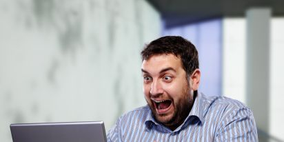 Excited Guy Looking at a Computer