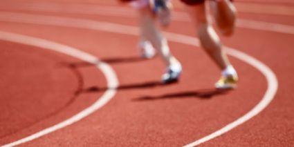 Runner Legs Running on a Track