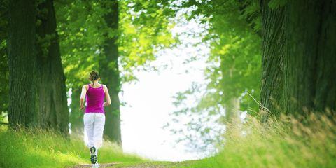 Woman running on green path