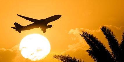 Airplane In Front of Sun