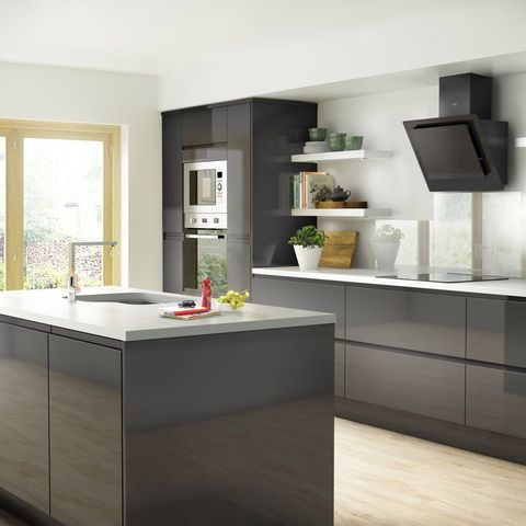 Grey kitchen with island and white worktops