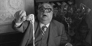Actor Aldo Fabrizi while eating spaghetti at the restaurant, Rome 1975