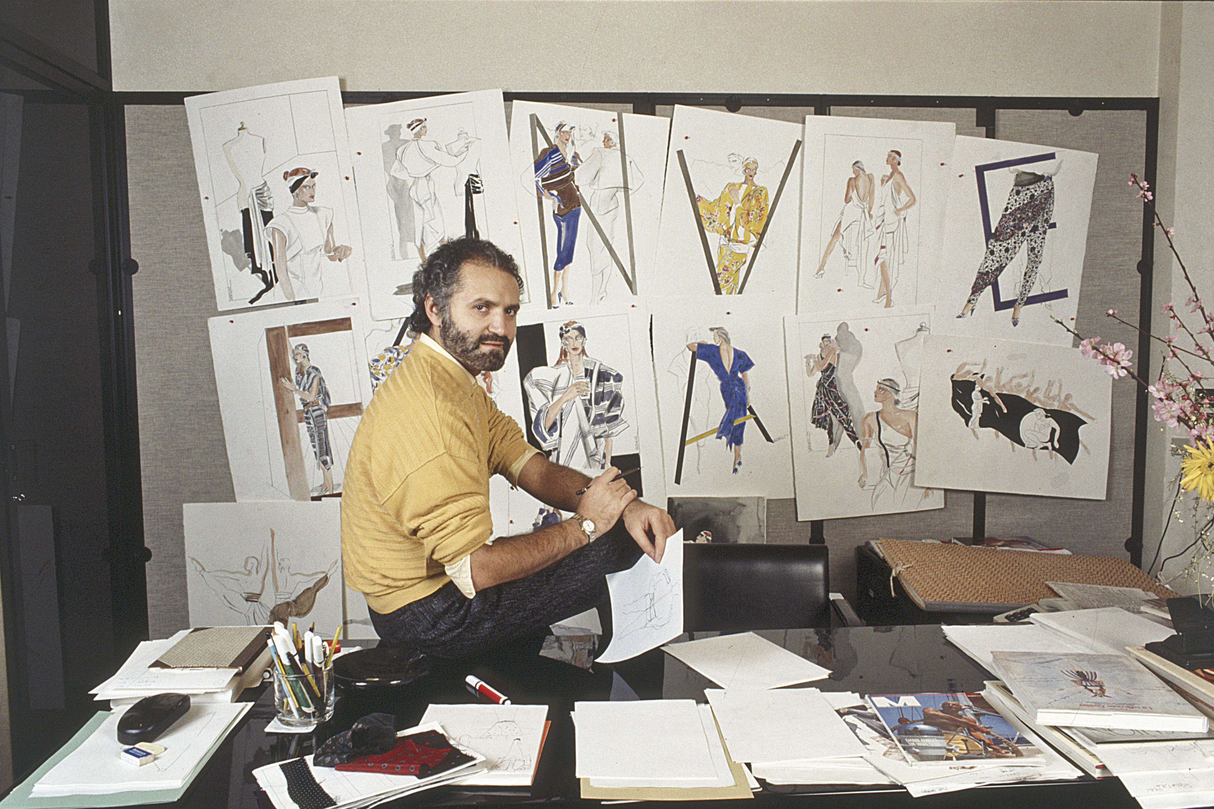Gianni Versace in his study