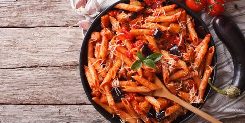 Italian Pasta alla Norma close-up and ingredients. horizontal to