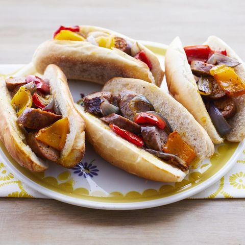 sheet pan sausage and pepper hoagies on yellow plate