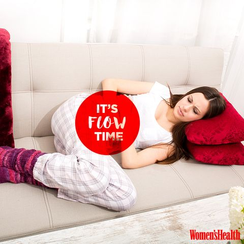 woman with pms period cramps laying on couch