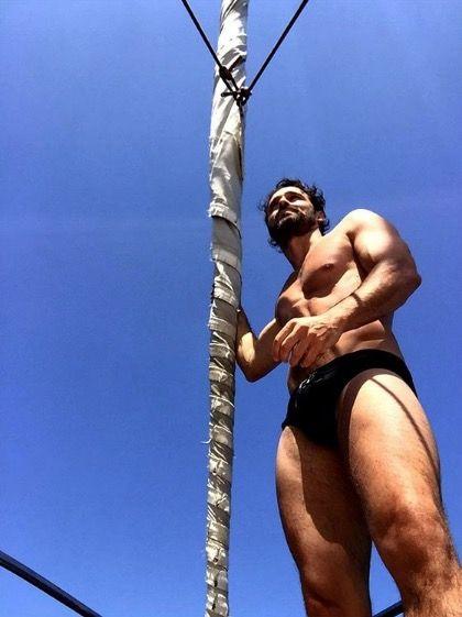 Muscle, Barechested, Rope, Adventure, Arm, Rope climbing, Leg, Human body, Pole vault, Climbing,