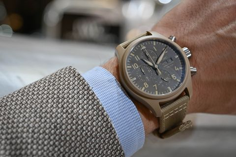 Watch, Analog watch, Watch accessory, Fashion accessory, Strap, Wrist, Material property, Jewellery, Hand, Metal,