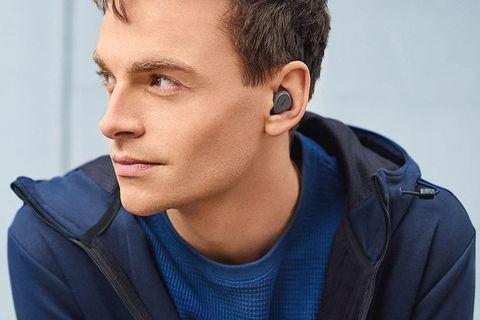 man wearing jabra elite 3 earbuds