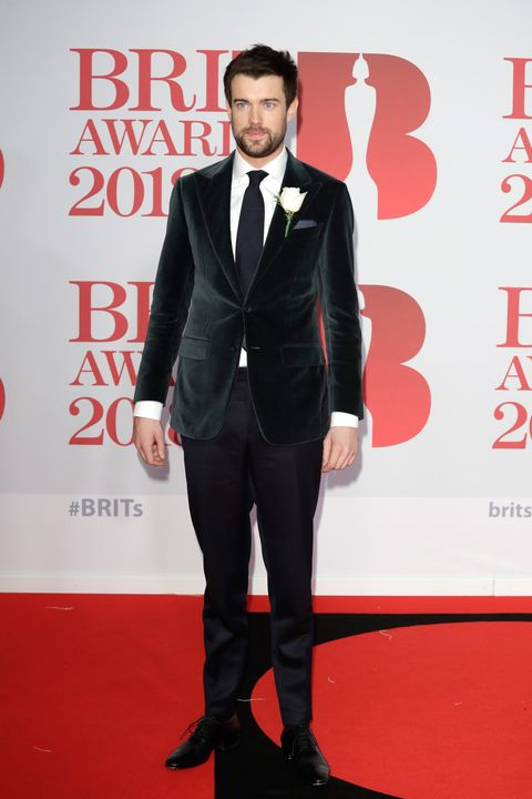 Suit, Carpet, Formal wear, Red carpet, Tuxedo, Clothing, Flooring, Tie, Premiere, Blazer,
