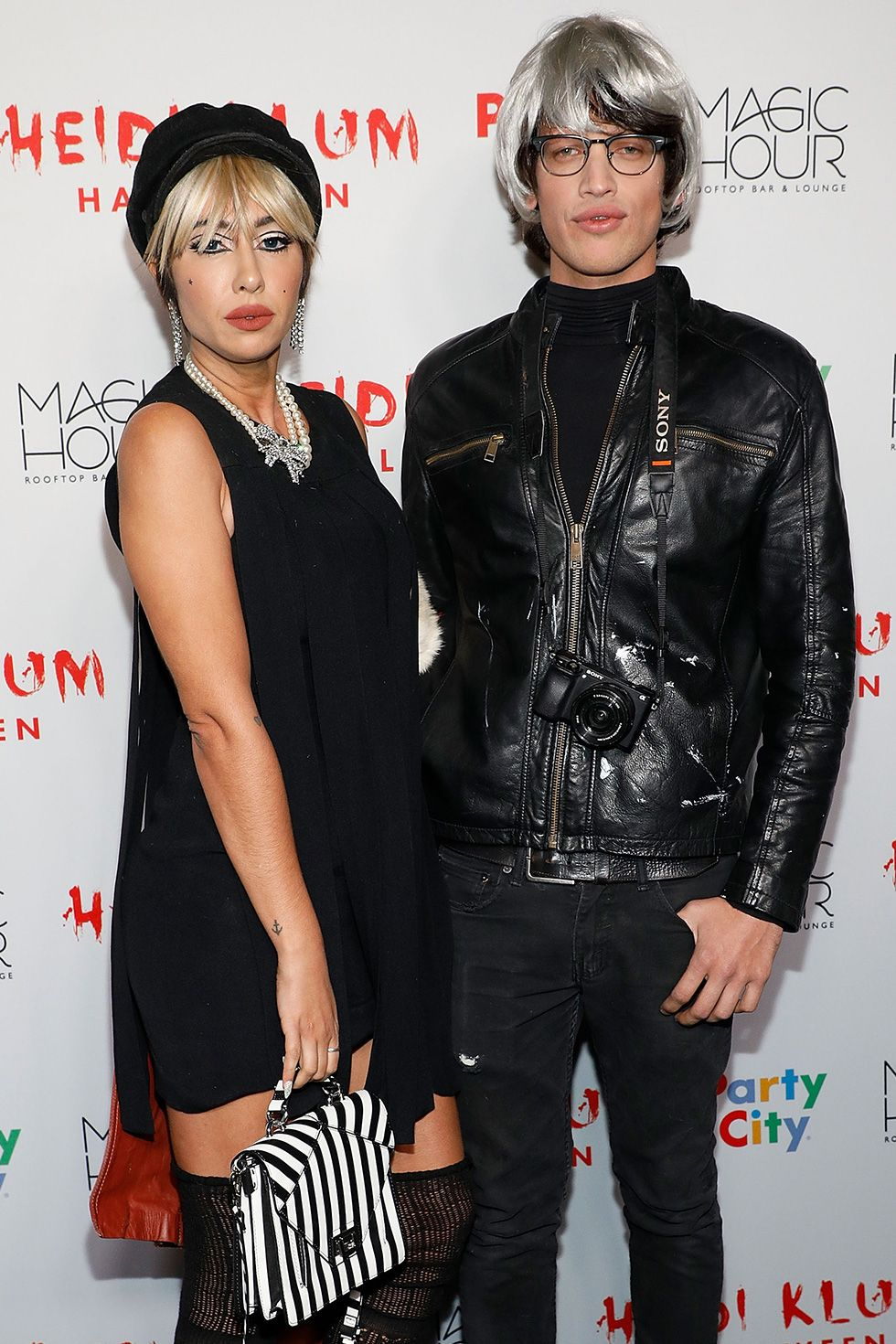 Jackie Cruz and Fernando Garcia - 1970s/Andy Warhol Actress Jackie Cruz and boyfriend Fernando Garcia went for a 1970s Andy Warhol-inspired look at Heidi Klum's 2017 Halloween party in New York City.