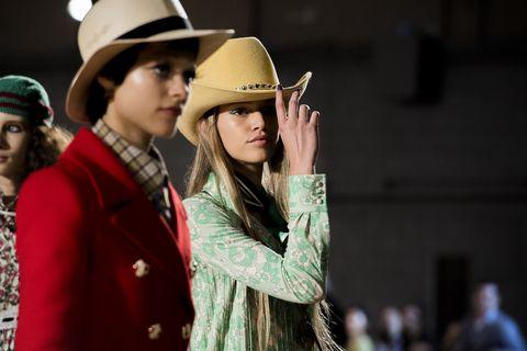 Hat, Yellow, Fashion, Headgear, Fashion accessory, Fedora, Street fashion, Event, Photography, Cowboy hat,
