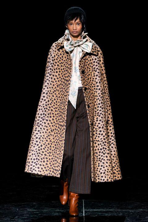 Clothing, Outerwear, Fashion, Mantle, Fashion model, Coat, Fashion design, Cloak, Formal wear, Costume,
