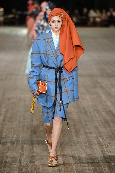 Fashion, Fashion show, Street fashion, Clothing, Orange, Runway, Outerwear, Footwear, Human, Fashion model,