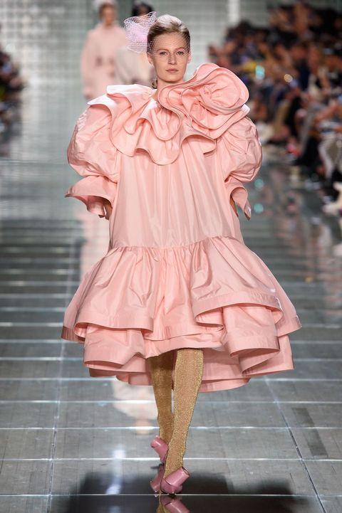 Fashion model, Fashion, Fashion show, Runway, Pink, Clothing, Haute couture, Shoulder, Outerwear, Fashion design,