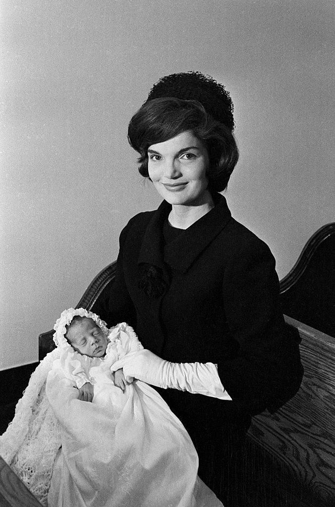Jackie Kennedy with newborn son, John F. Kennedy Jr. at his christening in Georgetown.