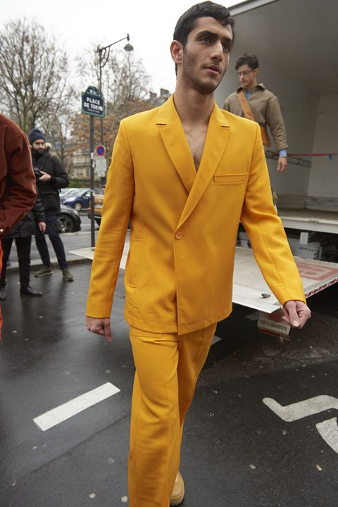 Suit, Yellow, Clothing, Orange, Fashion, Street fashion, Outerwear, Pantsuit, Blazer, Human,