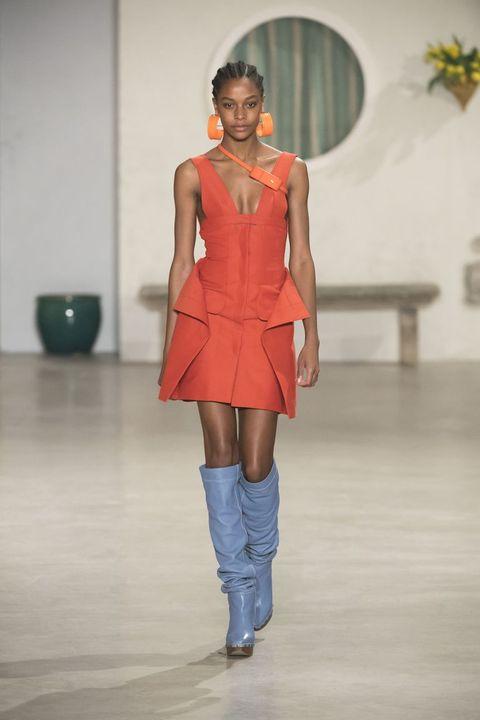 Fashion show, Fashion model, Fashion, Runway, Clothing, Shoulder, Fashion design, Orange, Joint, Public event,