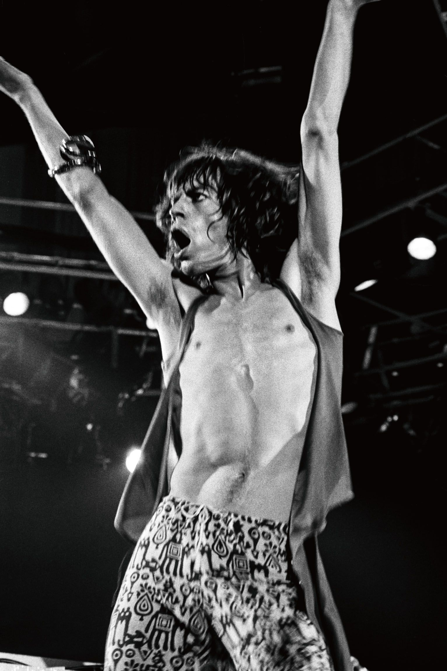 "Mick Jagger at San Francisco's Cow Palace, where the Rolling Stones performed over two nights in July 1975. According to Resnick, the show ""featured a huge inflatable phallus, which Jagger sang in front of."""