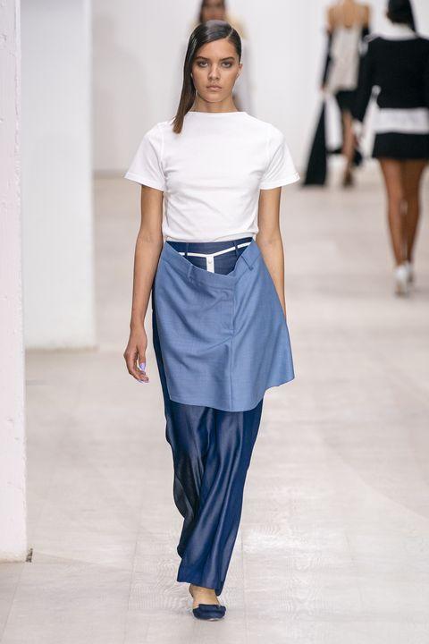 Fashion model, Fashion, Clothing, Fashion show, Runway, White, Shoulder, Blue, Waist, Haute couture,