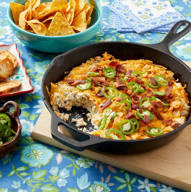 jalapeno popper dip with corn chips toasted bread and sliced jalapenos