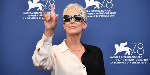 """us actress jamie lee curtis wears a pair of peggy guggenheim sunglasses as she attends a photocall for the film """"halloween kills"""" presented out of competition on september 8, 2021 during the 78th venice film festival at venice lido photo by marco bertorello  afp photo by marco bertorelloafp via getty images"""