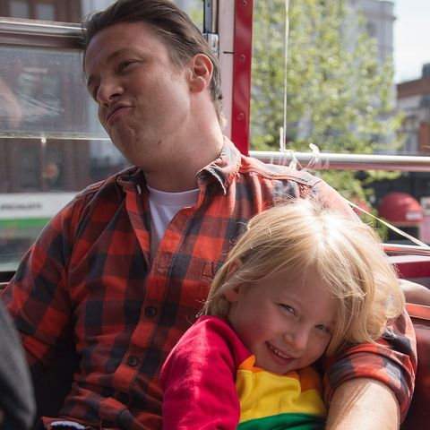 british chef and television presenter jamie oliver plays with his son buddy during an open top bus tour of london to promote food revolution day on may 15, 2015 jamie oliver is calling for a global campaign to put compulsory practical food eduction on the school curriculum of the g20 countries afp photo  leon neal        photo credit should read leon nealafp via getty images