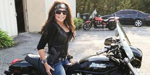Land vehicle, Vehicle, Motorcycle, Motorcycle accessories, Cruiser, Car, Motorcycling, Eyewear, Leg, Rocker,