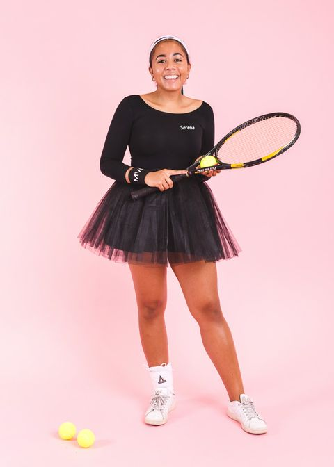 woman dressed as serena williams in black tutu skirt, holding tennis racquet and ball