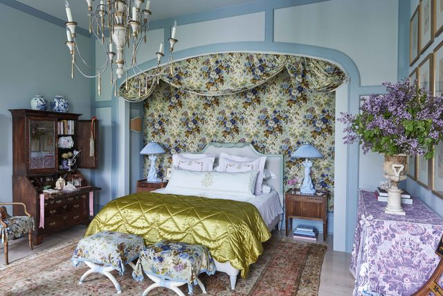 a dramatic boudoir where his broad bed niche nearly matched her own alcove and is draped with thirty yards of fabric