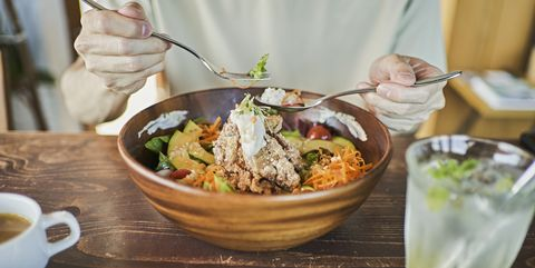 japanese man eating a vegan lunch at a vegan cafe