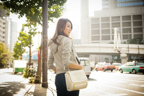 Japanese woman on street,side view