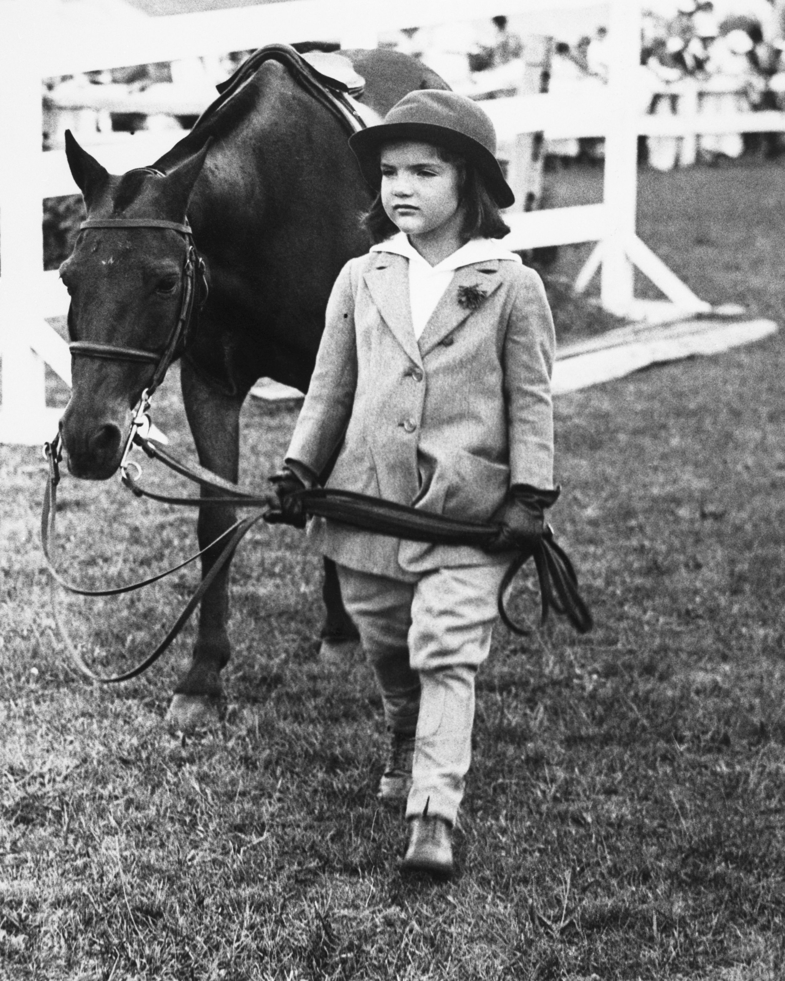 A young Jaqueline Kennedy (née Bouvier), leading a pony at a Southampton horse show.