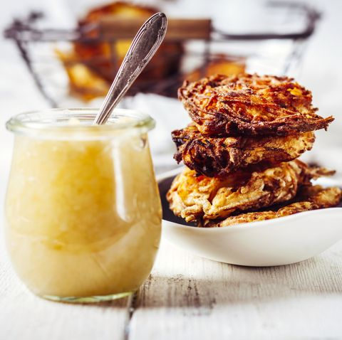 jar of apple sauce and bowl of crunchy jewish latkes