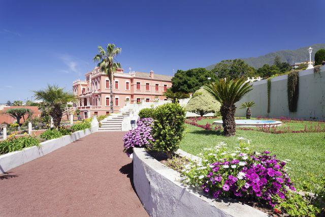 jardin marquesado de la quinta gardens, liceo de taoro in the back, la orotava, tenerife, canary islands, spain