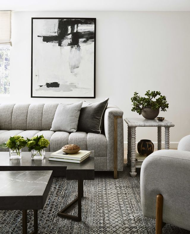 family room, gray sofa and gray lounge chair, black double coffee tables