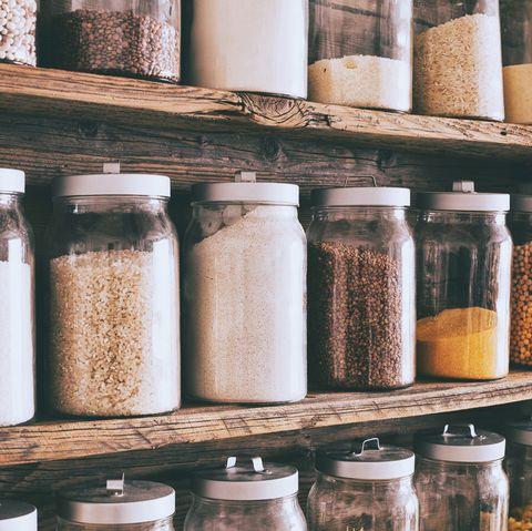 jars of ingredients on wooden shelves in pantry