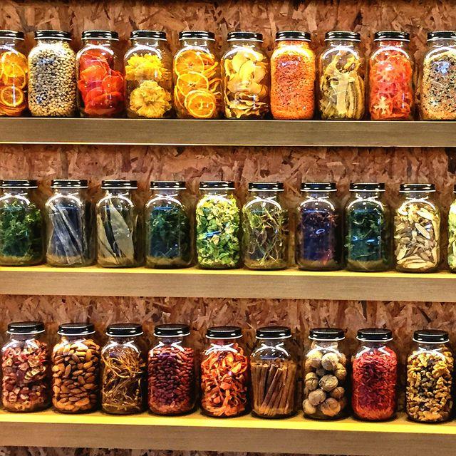 Jars With Various Food Arranged On Shelf