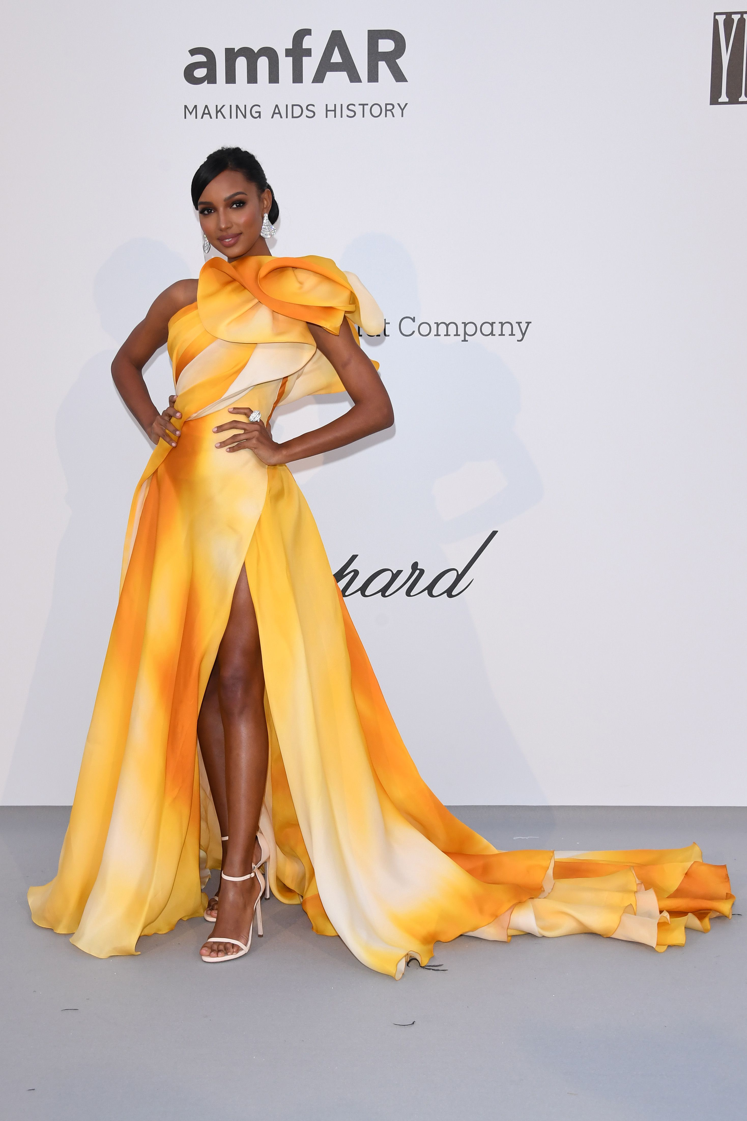 Jasmine Tookes In a yellow and orange asymmetrical gown.