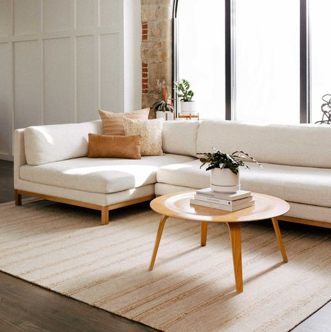 Furniture, Living room, Room, Floor, Interior design, Coffee table, Table, Couch, Property, Wood flooring,
