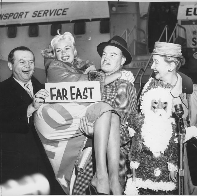 57–12–17 –– OPERATION SANTA CLAUS –– Jayne Mansfield is given a lift by Bob Hope as Johnny Grant, on