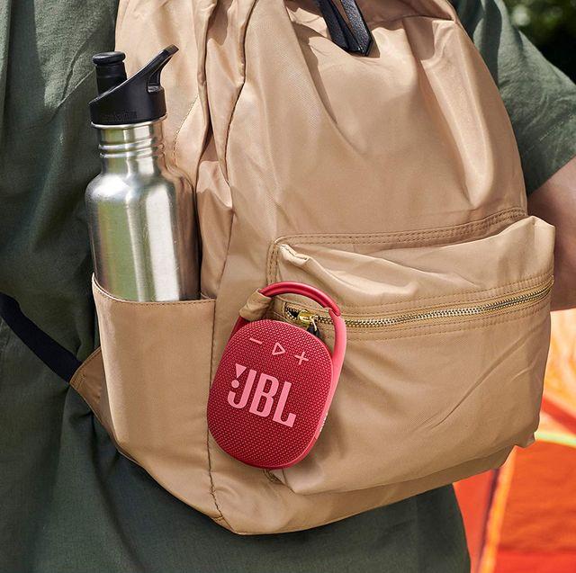 jbl mini bluetooth speaker clipped onto backpack