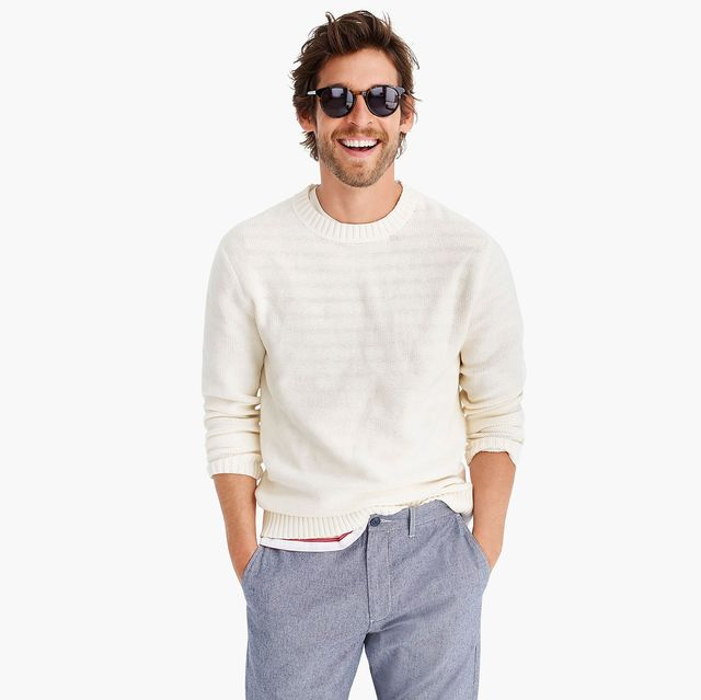 model wearing sunglasses and white sweater