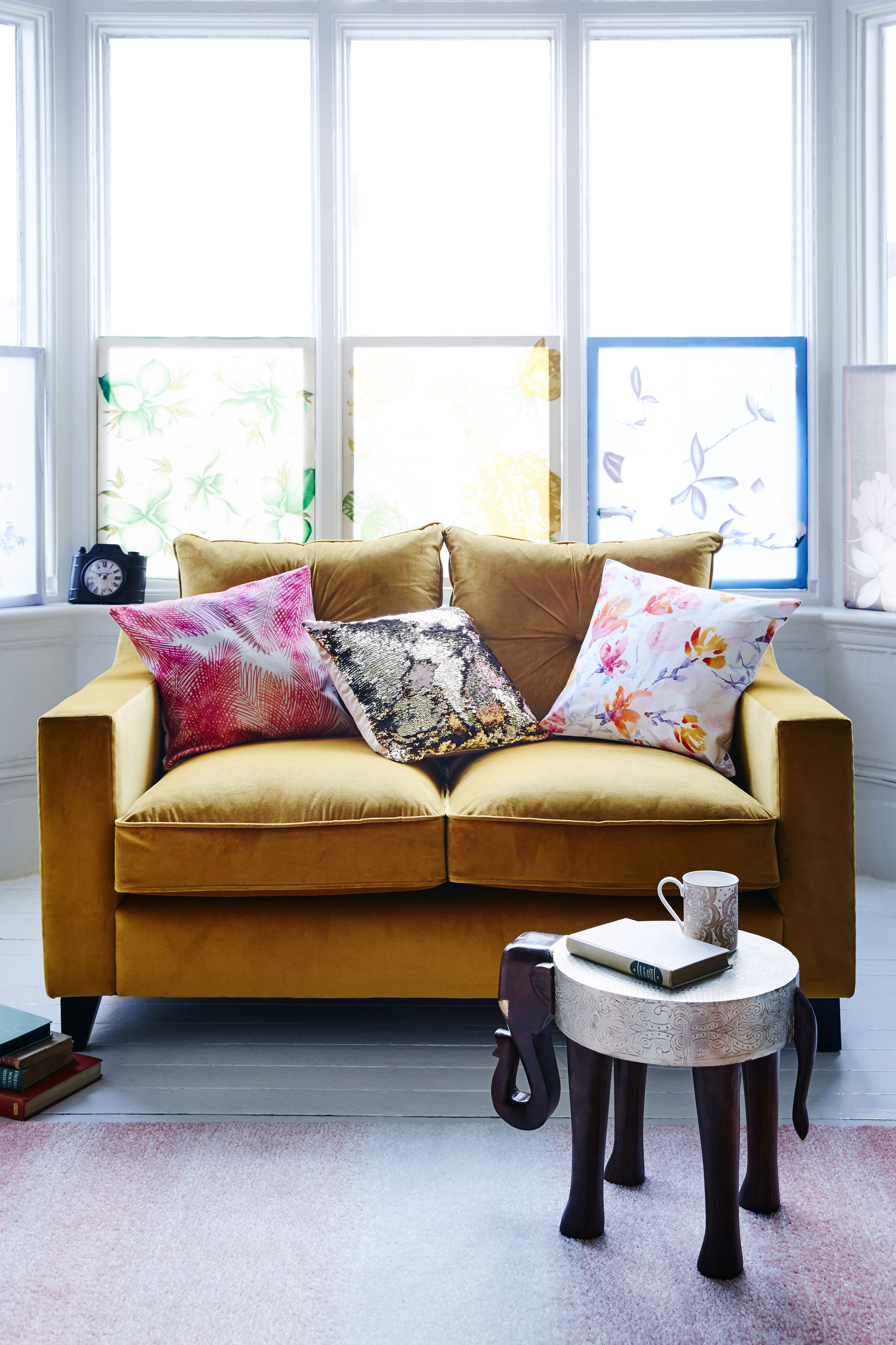 Yellow sofa and elephant sheesham side table from jd williams