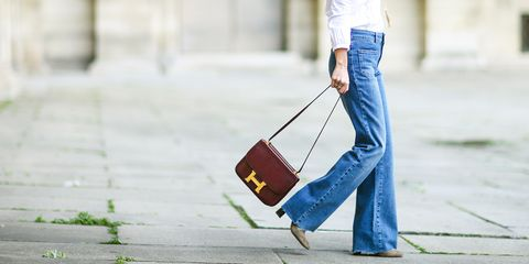 Jeans, Denim, Street fashion, Blue, Textile, Trousers, Shoulder, Footwear, Waist, Leather,