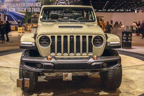 Land vehicle, Vehicle, Car, Automotive tire, Automotive design, Tire, Bumper, Auto show, Jeep, Off-road vehicle,
