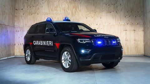 Land vehicle, Vehicle, Car, Regularity rally, Blue, Motor vehicle, Police car, Compact sport utility vehicle, Automotive design, Sport utility vehicle,