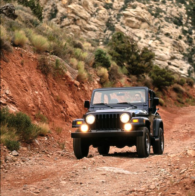 jeep wrangler off road in a rocky western setting